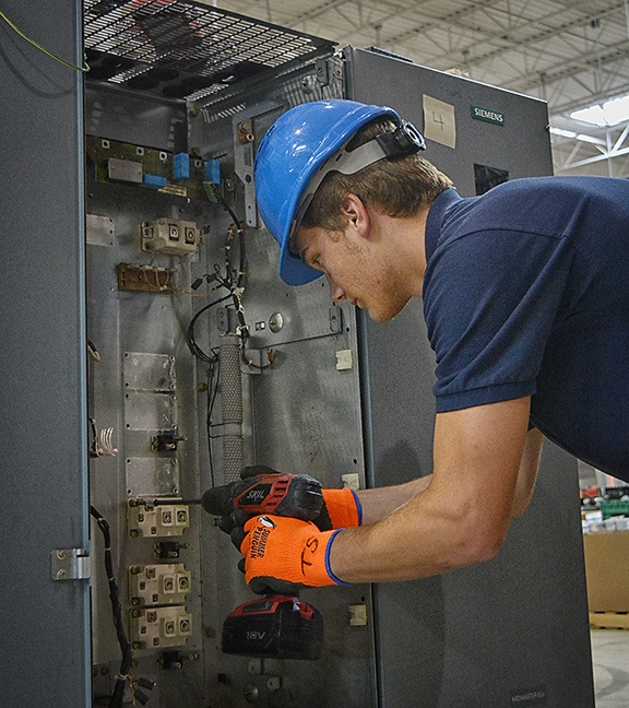 Employee Breaking Down Equipment