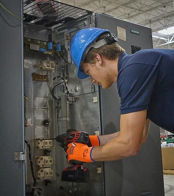Employee Breaking Down Equipment
