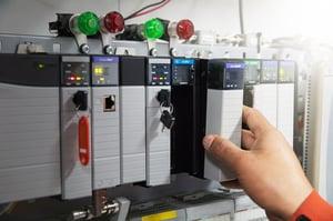 Hand Placing PLC into Rack