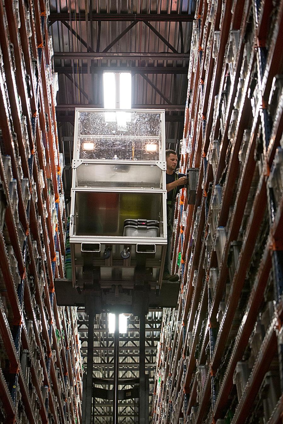 High Lift Picker in Warehouse