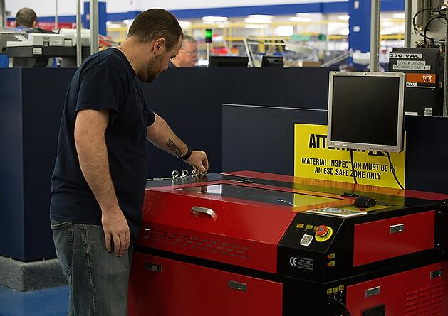 Operator working on KH7050 Laser Engraving Machine