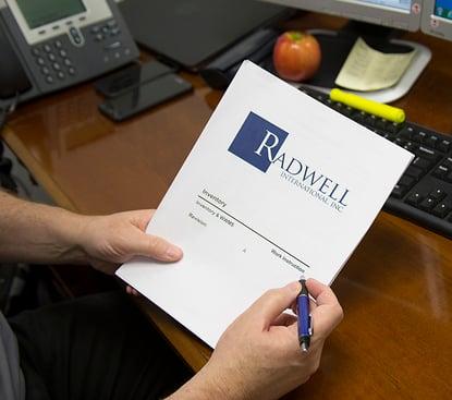 ISO-hand-holding-pen-document