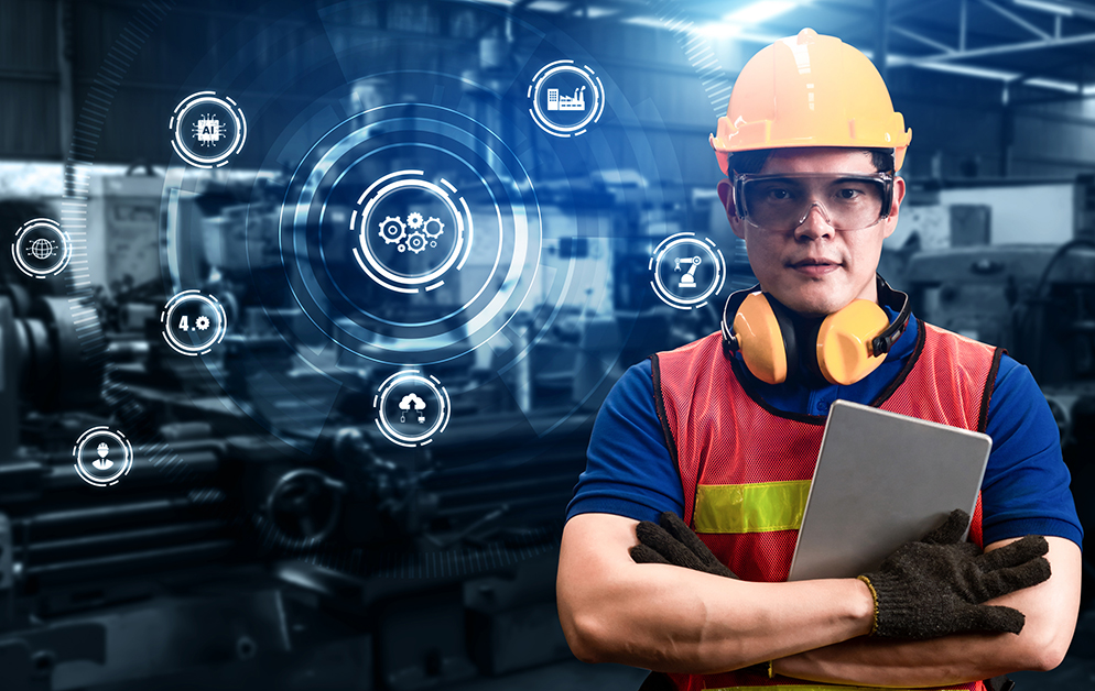 Plant Worker With Graphic Showing Wireless Technology concepts