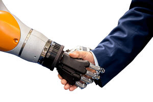 Robot Hand Shaking Male Hand In Suit