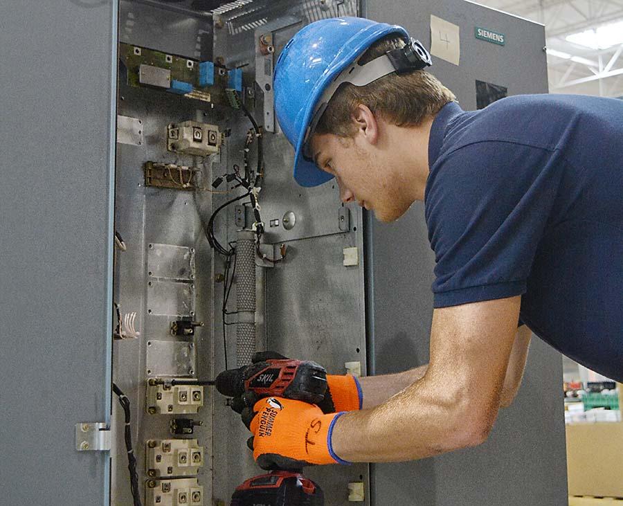 Radwell employee breaking down a machine