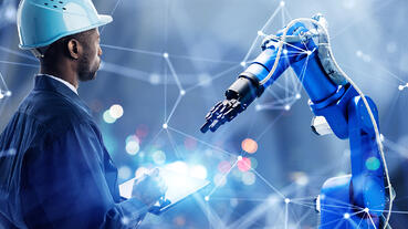 Worker Wearing Blue with Blue Robot Arm