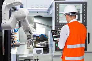 Worker in Orange Vest with Robot