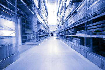 looking-down-blue-warehouse-aisle-motion-blur
