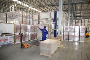 man-in-warehouse-unpacking-inventory