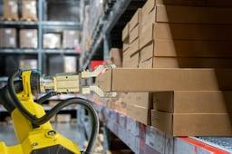 robot-grippers-pulling-box-off-warehouse-shelf