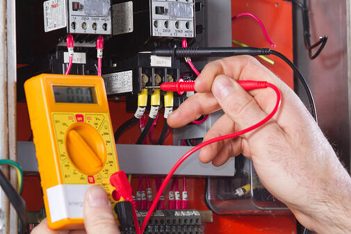 male using meter to test electrical equipment