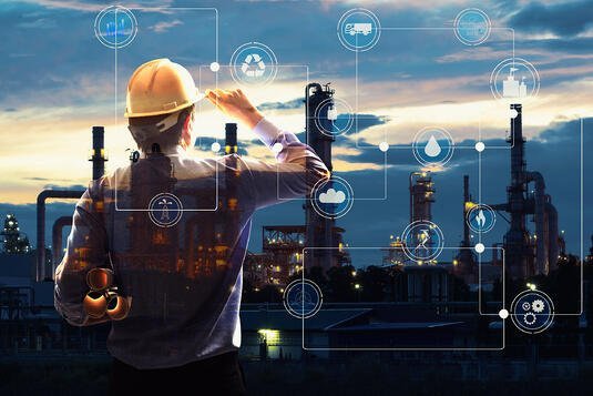 Man and graphic showing Industrial Internet of Things