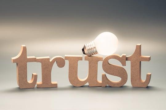 trust-lightbulb-gray-background